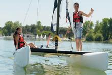 Young Couple On Catamaran
