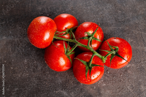 fresh tomatoes on stone background stockbilder