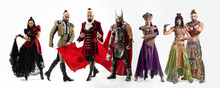 Bright Fairy Tale Characters In Costumes In Front Of White Background. Toreador, Scandinavian God Of Thunder And Lightning, Dancers, Egyptian Couple In Traditional Clothes. Creative Collage.