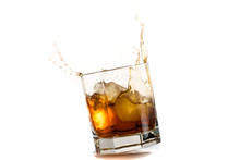 Fallen And Falling Whiskey Glass With Ice And Splashes