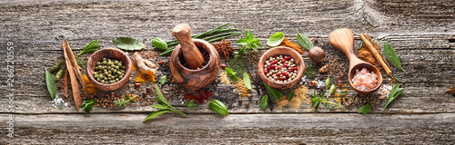 Fototapeta Spices and herbs on old wooden board obraz