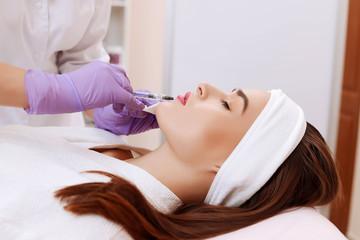 Obraz na płótnie Canvas Procedure filler injection in beauty clinic.