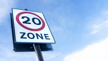 Traffic Road Sign For 20mph (miles Per Hour) Speed Limit Zone In The United Kingdom