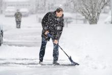 Man In Winter Coat Cleaning Sh...