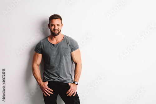 Happy handsome man on white background. Tableau sur Toile