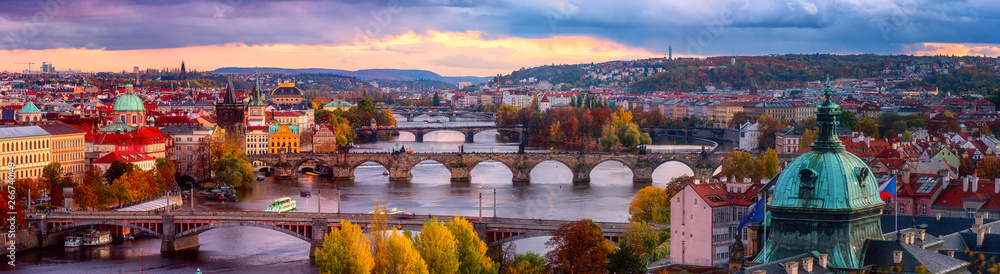 Fototapety, obrazy: Sunset in Prague panorama, view to the historical bridges, old town and Vltava river from popular view point in the Letna park, autumn landscape in sunset light with amazing cloudy sky, Czech Republic