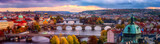 Sunset in Prague panorama, view to the historical bridges, old town and Vltava river from popular view point in the Letna park, autumn landscape in sunset light with amazing cloudy sky, Czech Republic