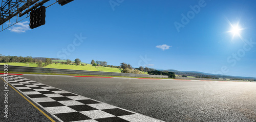 Wide angle view empty asphalt international race track with start and finish line , morning scene Fototapete