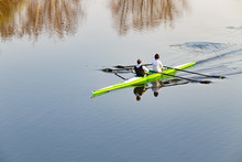 Man And Woman Rowing In Yellow...