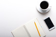 Top view of tablet, smartphone, calculator, notebook and a cup of coffee on white background