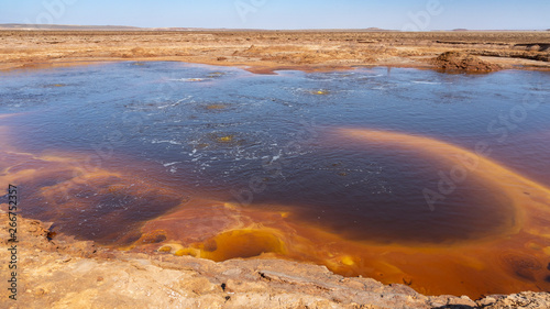 Foto op Canvas Cappuccino Acid bubbling pond in the Danakil depression in Ethiopia in Africa.