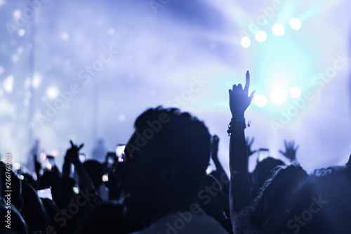 hands to the skies of people dancing and having fun at the live music concert - 266760703