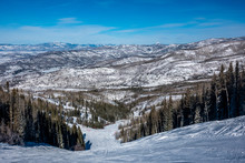 View Of The Mountains And Slopes Of Steamboat Springs, In The Rocky Mountains Of Colorado, Lined By Pine And Aspen Trees.