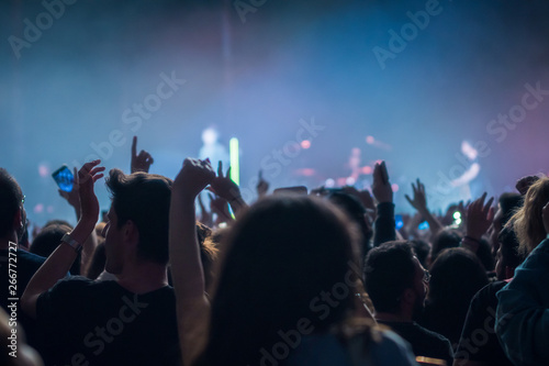 hands to the skies of people dancing and having fun at the live music concert - 266772727