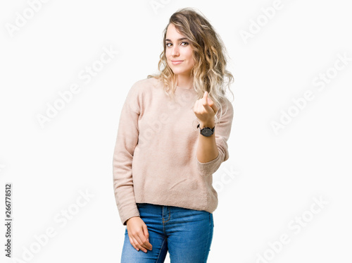 Beautiful young blonde woman wearing sweatershirt over isolated background Becko Canvas Print