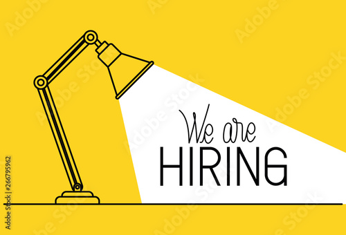 Fotografering lamp desk with we are hiring message