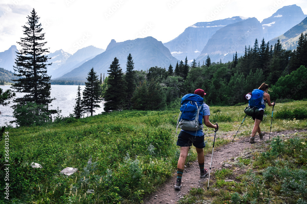 Fototapety, obrazy: Women Backpacking in Glacier National Park in Montana During Summer