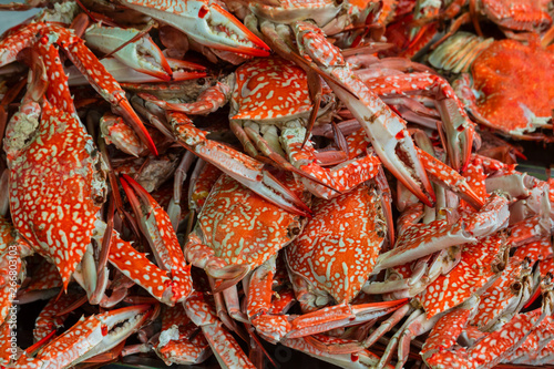 Fotobehang Schaaldieren A tray of fresh red crabs stacked in layers in a wet market in Thailand