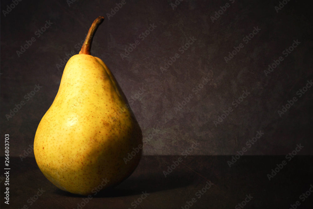 Obraz Pear on dark grunge background. Still life with juicy pear fototapeta, plakat