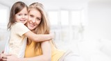 Portrait of happy mother and daughter holding - 266806386
