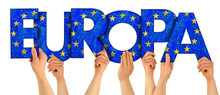 People Arms Hands Holding Up Wooden Letter Lettring Forming German Word Europa(english Translation: Europe) In European Union National Flag Colors  Travel Elections Concept Isolated Whitbackground