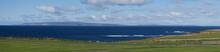 A View Across From Mey In Caithness Across The Pentland Firth To The Island Of Hoy, Part Of The Orkney Archipelago In Scotland, UK