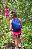 Young girl with her mother exploring forest trail - 266816948