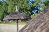 Straw beach umbrella on a beautiful beach - 266816973