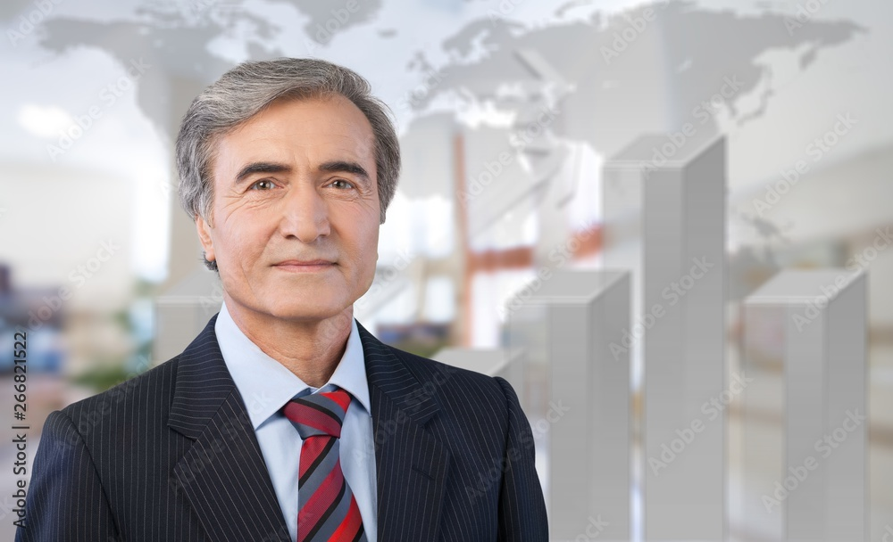 Fototapeta Mature confident Businessman on background
