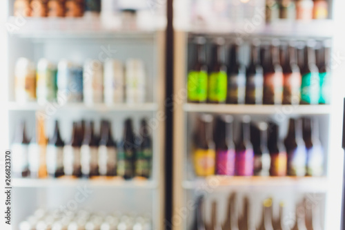 Poster de jardin Bar Background Blurred Defocused Beers are cooling in fridge, freezer or refrigerator shelf. Defocused Blurry Night life, Night Club, Bar, Pub, Store or Grocery Background concept image.