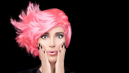 Fashion model girl with stylish pink hair. Beauty salon hair coloring concept...