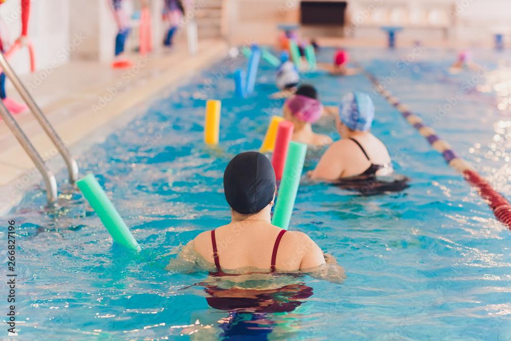 Fototapety, obrazy: women trains in aqua aerobics, learn to swim.