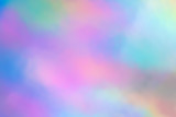 Fototapeta Rainbow - Blurry abstract iridescent holographic foil background.