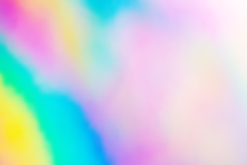 Blurry abstract iridescent holographic foil background.