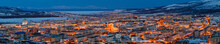 Panorama Of The City Of Magadan. Top View Of The Northern City. Beautiful Night Cityscape With Lots Of Buildings. Bright Street Lighting At Dusk. Magadan, Siberia, Far East Of Russia. Panoramic Photo.
