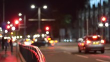 A Fixed Shot Of Blurred Traffic At Traffic Lights. Would Make A Great Website Background Video. This Shot Was Taken On Edinburgh Princes Street In Scotland. 50mm Lens At 24 Fps