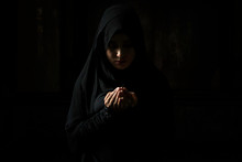 Muslim Women Wearing Black Shirts Doing Prayer According To The Principles Of Islam..