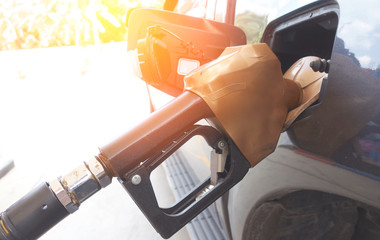 Close-up fuel nozzle. Filling gas at the station.