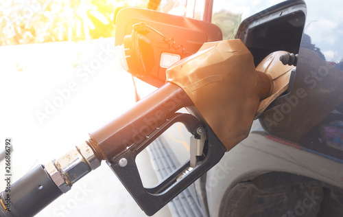 mata magnetyczna Close-up fuel nozzle. Filling gas at the station.