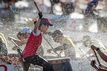 Dragon Boat Drummer Racing Through Spray