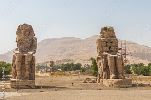 Photo Stands Egypt Two massive stone statues Colossi of Memnon Thebes, Luxor, Egypt