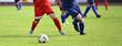 canvas print picture - Fussballspieler beim Fussball spielen
