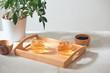 Leinwandbild Motiv Hot tea is in the glass. Placed on a wooden tray.