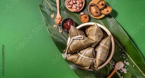 Zongzi, steamed rice dumplings on green table background, food in dragon boat fe Canvas Print