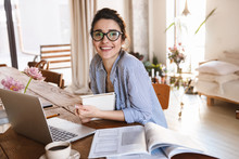 Image Of Cute Young Woman 20s Typing On Laptop While Working Or Studying At Home