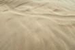 Yellow Wavy Sand Dune Desert Beach Coast Surface Natural Texture.