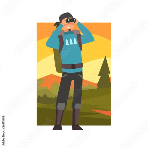 Man with Backpack Looking Through Binoculars, Guy in Summer Mountain Landscape, Fototapet