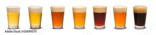 Photo Set of many beer glasses with different beer isolate on white background