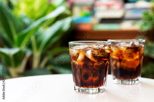 Fotografie, Obraz  a glass of cola with iced on white table