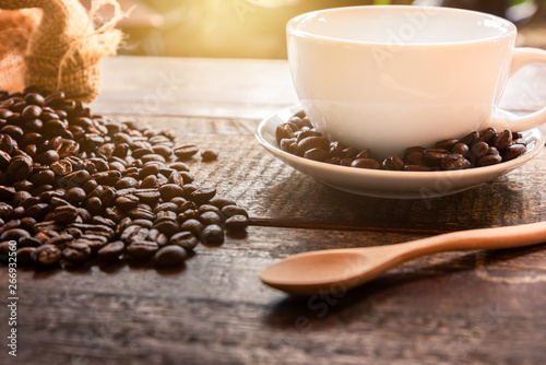 Photo Stands Coffee beans Coffee in a cup on a wooden table,